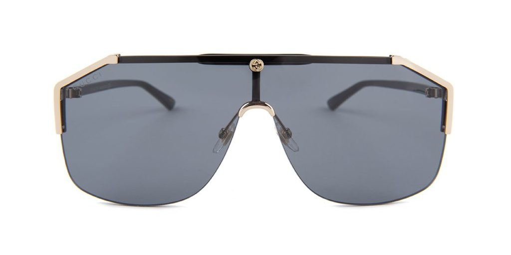 2b182518fd8 About the Gucci GG0291S sunglasses  Showcasing gold mirrored shield-like  lenses