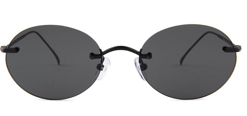 J. Balvin tiny oval sunglasses style